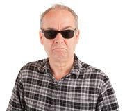Zdegustowany facet Jest ubranym okulary przeciwsłonecznych Obraz Royalty Free