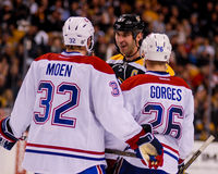 Zdeno Chara chats with Travis Moen and Josh Gorges. Stock Photos
