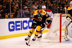 Zdeno Chara clears the puck. Royalty Free Stock Photos