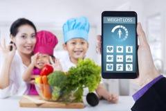 Zdrowa rodziny i ciężaru strata app Zdjęcia Stock