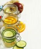 Zdrowa zdrój woda z owoc i warzywo i pomarańczowa zdrój woda Obraz Royalty Free