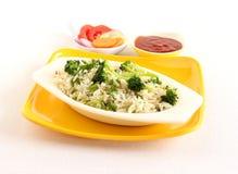 Zdrowi karmowi brokuły ryżowi z ketchupem i sałatką Fotografia Royalty Free