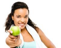 Zdrowi potomstwa mieszający biegowy kobiety mienie zielenieje jabłka odizolowywającego na w Obraz Stock