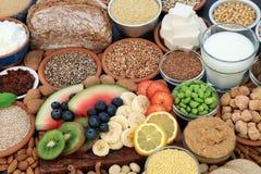 Zdrowia jedzenie dla weganinów z migdałowym masłem, jogurtem & mlekiem, tofu bobowy curd, adra, ziarna, dokrętki, owoc, warzywa,  obrazy stock