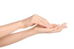 Zdrowie i ciała opieki temat: piękna żeńska ręka z białą śmietanką odizolowywającą na białym tle, ręka masaż Zdjęcie Stock