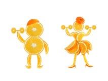 Zdrowy łasowanie. Śmieszna mała para pomarańczowi plasterki. Zdjęcie Royalty Free