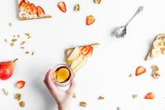 Zdrowy śniadanie z kanapkami ustawia i ręki na białego tła odgórnym widoku Zdjęcie Stock