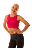 Zdrowy styl życia - Dysponowana blnde kobiety poza nad bielem Zdjęcia Royalty Free