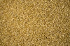 Zdruzgotana pszeniczna groats tła tekstura fotografia stock