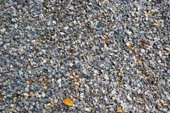 Zdruzgotany siwieje kamiennego tło Zdjęcia Stock