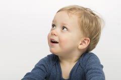 Zdziwiona chłopiec odizolowywająca na białym tle Śliczny berbeć z pytać twarzy wyrażenie Uroczy dzieciak pyta co jest zdjęcia royalty free