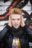 Zdziwiona męska twarz na graffiti ścianie Obraz Royalty Free
