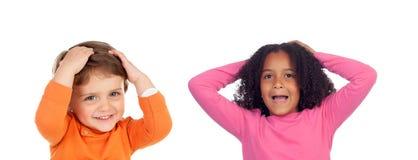 Zdziwiona para dzieci obraz royalty free