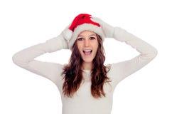 Zdziwiona przypadkowa dziewczyna z Bożenarodzeniowym kapeluszem Obraz Stock