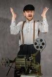 Zdziwiony brodaty projectionist zdjęcia stock