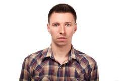 Zdziwiony mężczyzna w szkockiej kraty koszula Obrazy Stock
