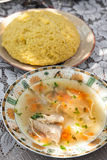 Zeama soup with mamaliga Stock Photo
