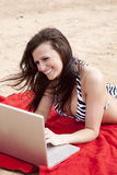 Zebra bikini and laptop Royalty Free Stock Photography