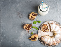 Zebra bundt cake cut into pieces and mint leaves Royalty Free Stock Images