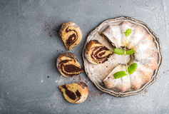 Zebra bundt cake cut into pieces and mint leaves Stock Image