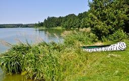 Zebra canoe on lakeside Royalty Free Stock Images