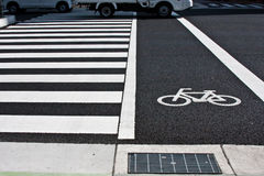 Zebra crossing. Traffic sign for pedestrian and for bicycle Royalty Free Stock Photography