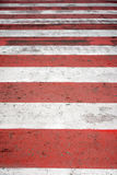 Zebra crossing. Close up of zebra crossing with red and white stripes Royalty Free Stock Photos