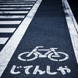 Zebra crossing. And bicycle sign on the street in japan Stock Photos