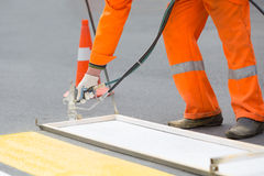 Zebra-crossing painting during road works Royalty Free Stock Image