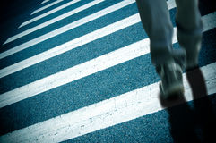 Zebra crossing and pedestrian Stock Images
