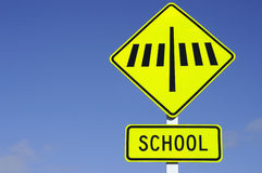 Zebra crossing road sign with school Royalty Free Stock Photos