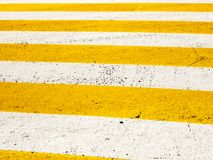 Zebra crossing, street pedestrian crosswalk with white and yellow stripes royalty free stock photos