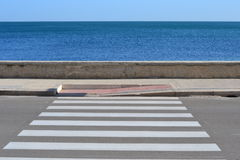 Zebra crossing to the sea. Zebra crossing on the road to the Adriatic sea Stock Photography