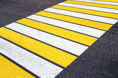 Zebra crossing with white and yellow lines Stock Photos