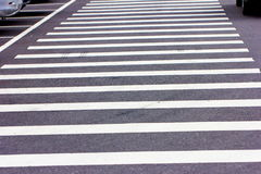 Zebra crosswalk on the road. For safety when people walking cross the street Stock Photography