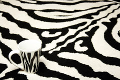 Zebra cup on zebra carpet royalty free stock photos