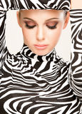 Zebra fashion. Gorgeous young woman posing in zebra pattern outfit Royalty Free Stock Photos