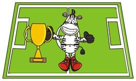 Zebra holding a gold cup Stock Photos