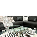Zebra living room. Living room with zebra hide and leather sofa Royalty Free Stock Photo