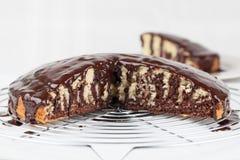 Zebra marble cake with chocolate glaze Royalty Free Stock Photography