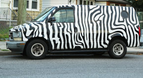 Zebra painted GMC Safari van Stock Image