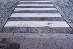 Zebra pedestrian crossing on asphalt road Royalty Free Stock Images