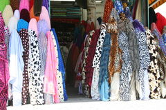 Zebra Prints. Rolls of fabric lined up on a street market Stock Image