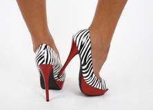 Zebra shoes on legs Royalty Free Stock Image