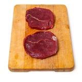 Zebra steaks on board Royalty Free Stock Photos