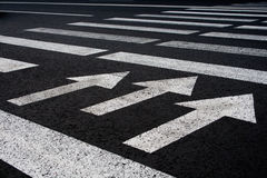 Zebra traffic walk way with arrows background Royalty Free Stock Images
