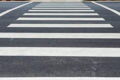 Zebra traffic walk way on asphalt road Stock Photos