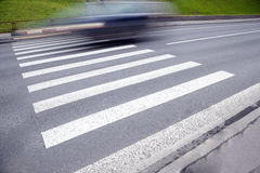 Zebra way on asphalt road Royalty Free Stock Photo