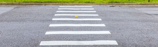 Zebra way on asphalt road surface Royalty Free Stock Image