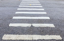 Zebra way on asphalt road surface Royalty Free Stock Photos